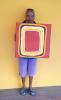 Anne Nunn with her work, Kunjuri, Shield at Bana Yirriji Art Centre. Image: Bana Yirriji Art Centre