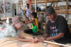 Elliot Koonutta teaching spear making. Image: Pormpuraaw Arts and Cultural Centre