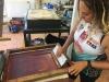 Luanna de Jersey printing merchandise. Image: Wei'num Arts