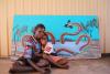 Joelene Roughsey and daughter Mandy with her Rainbow Serpent artwork painted during the IACA Belonging workshop at Mornington Island Art, May 2019. Image: IACA Edwina Circuitt